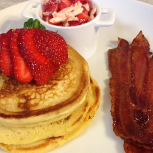 Candied bacon - accompanied by buttermilk pancakes, and strawberry butter!